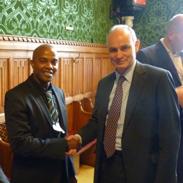 'Michael with Crispin Blunt the parliamentary secretary of state for prisons and youth justice at the House Of Lords 2012, 'Safe Ground's' symposium day, where Michael was guest speaker alongside Digby Griffith, Director  (NOMS). subject matter desistance from crime.