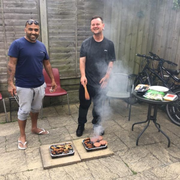 Service users at supported Move on Homes enjoying a BBQ in the summer