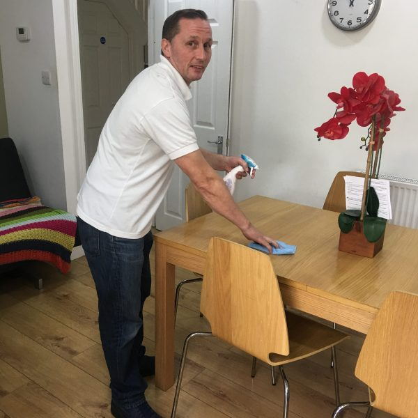 Service user doing house chores.