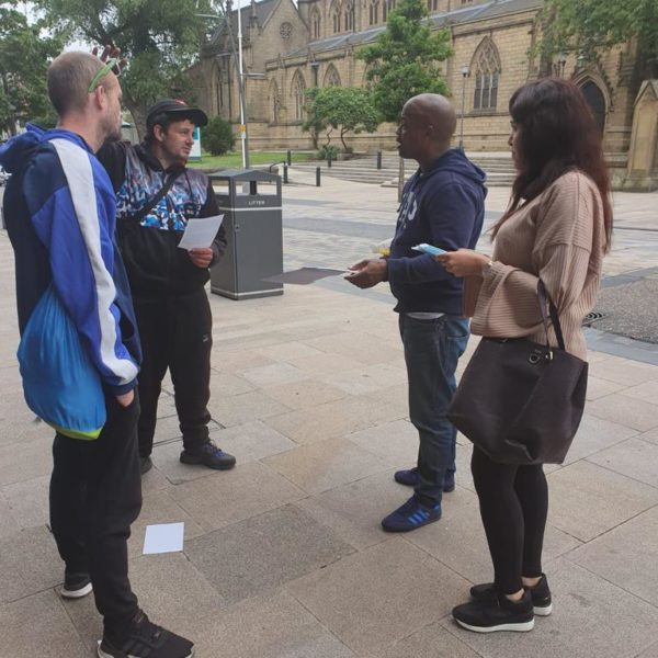 Support worker Lya Hall and Managing Director Michael Brown engage those afflicted in Preston City centre.