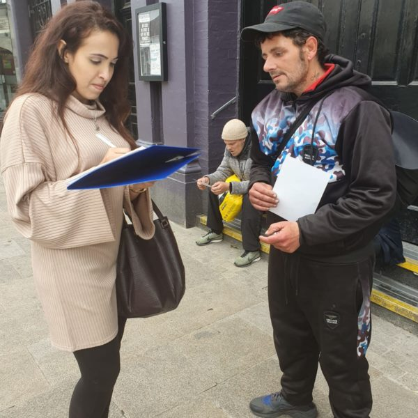 Lya Hall taking the necessary steps with a potential service user with the hope to provide supported housing.